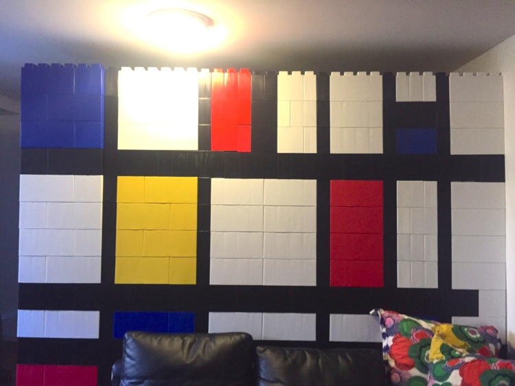 Use color and block variety to create really incredible artistic walls and room dividers like this Piet Mondrian inspired design.